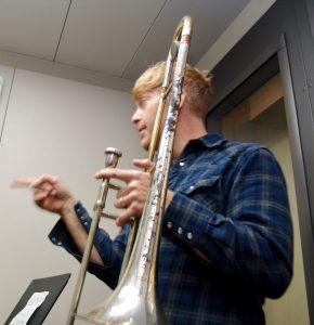 man holding trombone