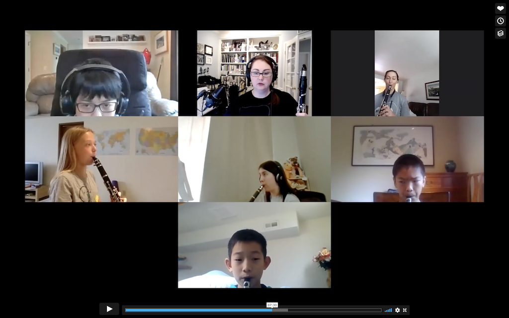 Woman leading an online clarinet workshop with six students